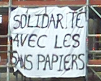 Banner drop - in solidarity for those without papers